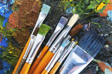 Set of brushes and an artist palette