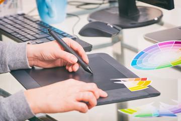Designer using graphics tablet