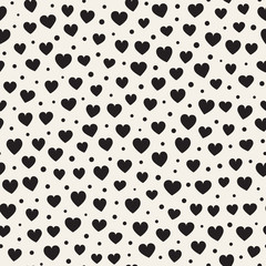 Seamless monochrome pattern with hearts and dots. Vector repeating texture.