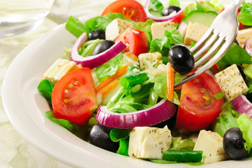 Fresh green summer salad Meditteranean with olives.
