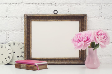 feminine mock-up with vintage frame and pink flowers on a white desk