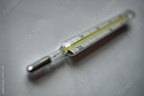 Isolated mercury thermometer displaying the measuring scale