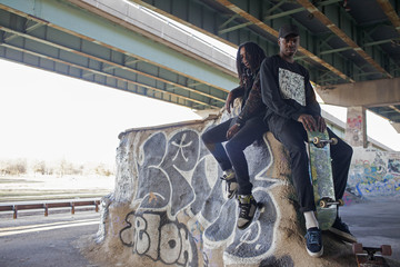 Two young men at a skateboard park.