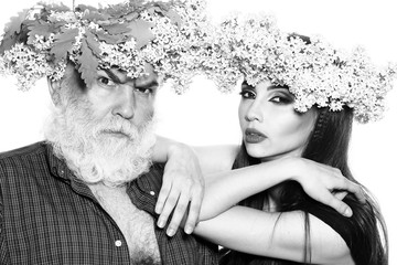 Man and woman in wreathes
