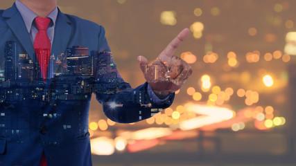 business man hand touching virtual screen on blurred city bokeh