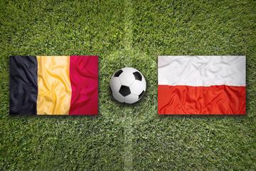 Belgium vs. Poland flags on soccer field