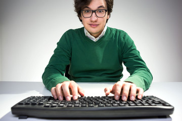 Surprised young man using keyboard