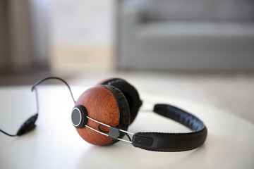 Stylish headphones on table