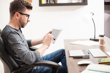 Designer using a tablet computer for work