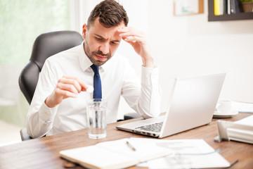 Businessman feeling unwell at work