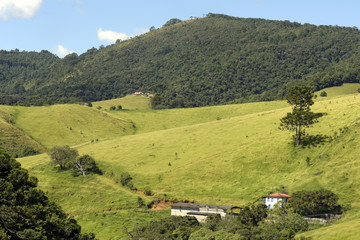 Green hills with farm house
