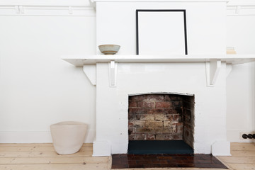 White brick fire place in vintage styled interior