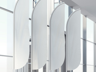 Four vertical wind banners in office. 3d rendering