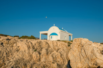 Little church by the rocky sea shore