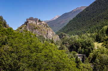 Middle Age castle and forest, Queyras region, Alps, France