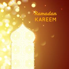 Ramadan Kareem greeting on gold bokeh background