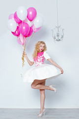 Young beautiful blonde and balloons