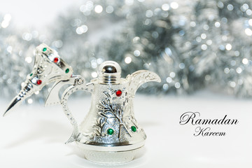 Ramadan Kareem Background.Silver arabic coffee pot in out of focus background