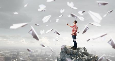 Guy take photos on mobile phone