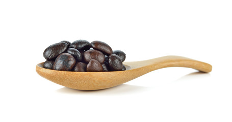 Coffee bean on wooden spoon isolated on white background