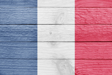 French flag on a wooden plank