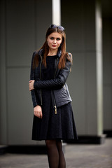 Fashion concept. Beautiful young woman in nice black dress.   City lifestyle. Female fashion.