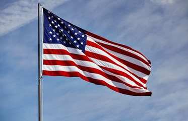 Flag USA in wind on flagpole with sky