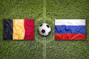 Belgium vs. Russia flags on soccer field