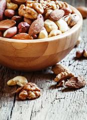Set of different nuts, useful healthy food, vintage wooden backg