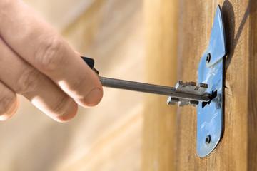 hands unlocking door, closeup