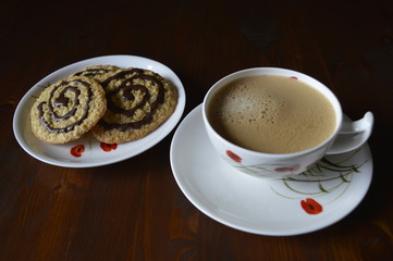Homemade cookies, oatmeal cookies with chocolate, healthy biscuits, with cup of coffee, milk coffee