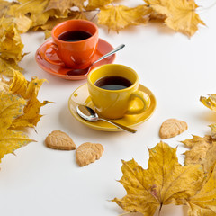 Autumn. Two cups of coffee and cookies in the shape of the leave
