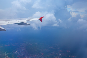 Above the clouds.Wing aircraft in the sky under earth of Bali,Indonesia
