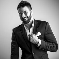 Elegant young handsome man. Black-white studio fashion portrait.