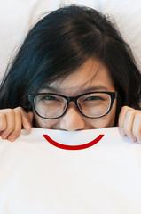asian woman wear eyeglasses waking up.