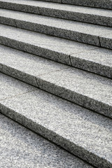 Diagonal close up of granite stairs as a background