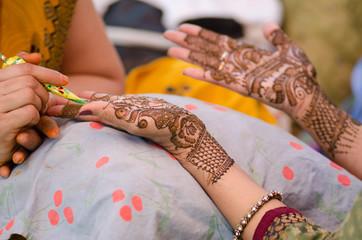 applying henna on hand, Hindu wedding ,Rajasthan, India