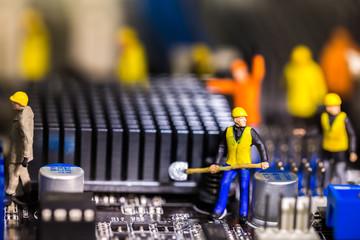 Team of engineers repairing circuit mother board.