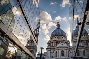 Canvas Prints Narrow alley St Paul's cathedral seen from a narrow alley enclosed by glass buildings on a cloudy day in summer