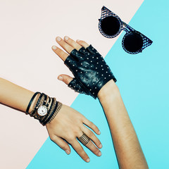 Stylish Lady Accessories. Jewelry, leather gloves, goggles. Blac