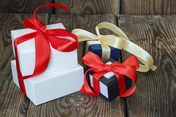 Three multicolored gift boxes with red and yellow ribbons