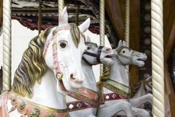 White carousel horses
