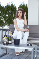 Beautiful sexy woman luxury lifestyle sit outdoor cafe bar