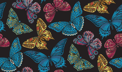 Seamless pattern with  ornate doodle hand drawn butterflies.