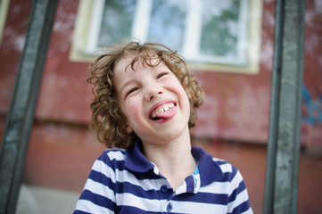 Boy laughing with his tongue out