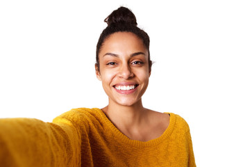 Cheerful young african woman taking selfie