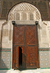Elaborate carved wooden door to the Bou Inania madrasa in Fez, M