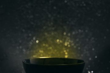 Magic Bowl/ Bowl with magic Lighting in the Dark Background
