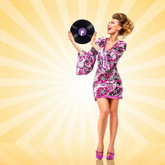 Old pleasant sound / Colorful photo of a happy fashionable hippie homemaker with a retro vinyl record in her hands on colorful abstract cartoon style background.