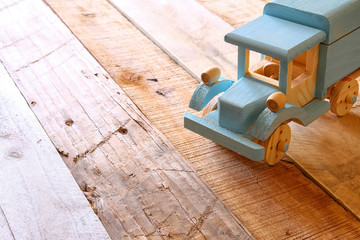 old wooden toy car over wooden table